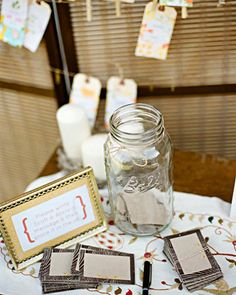Guests wrote well wishes on cards embellished with a faux bois border and two small yellow birds, which were then held in a large mason jar