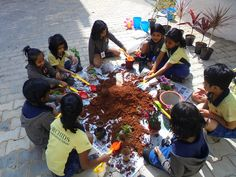 """To create awareness in children about how the trees grow , the role that trees play in preserving the Mother Nature and its contribution towards mankind . To recap the theme of nature and environment & as a culmination to this theme we had organized """"Pot a plant"""" for K1 & K2 children in the school on Wednesday 28th January 2015. Children were excited to fill soin in their pots & they planted the saplings , they also watered the saplings. This event was very informative for children."""