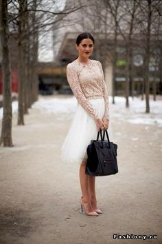 White tulle skirt, cream lace top.