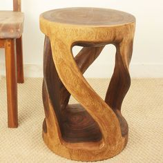 Small carved twisted stool. Hand-carved from sustainable monkey pod wood. Cute end table!