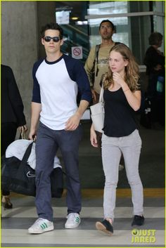 Dylan O'Brien and Britt Robertson make their way through the airport terminal together on Saturday afternoon (September 14) in Vancouver, Canada.