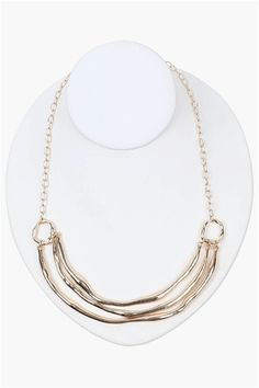 An awesome statement necklace that has three tiers throughout in rough gold. Has multiple holes for length adjustment. Comes with matching earrings.