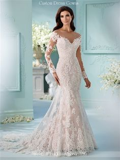 2016 Lace Wedding Dress. Beaded Sequin Alencon Lace on Tulle Over Satin Fit & Flare Mermaid Gown with an Illusion Bateau Neckline Over Sweetheart, Faux Off the Shoulder Illusion Lace Long Sleeves, Alencon Lace Fitted Bodice Past Hips, Scattered Lace Through Fit & Flare Mermaid Cage Skirt with Scalloped Hem, Lace Chapel Train Over Satin Brush Train, Illusion Lace High Back Over Low Back Interior with Buttons. #fitandflare #weddingdress #2016weddingdress #mermaid #longsleevewedding #laceback