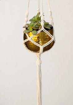 Medium Bronze Planter / Macrame Hanging Planter / Golden Pottery / Modern Home Decor / Boho Gift Idea by UtilartMacrame on Etsy https://www.etsy.com/listing/215422181/medium-bronze-planter-macrame-hanging