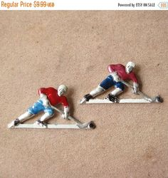 This listing is for a set of 2 pins which was made in a shape of a hockeyists  All badges are in a great condition.  Sizing: 55 mm by 30 mm (2.1/8 by 1.1/8 inch).  More hockey theme pins available here: http://etsy.me/1CkxaRF  ***************************************** When and how you will get your order?  ♥ All items will be shipped from Ukraine; ♥ All paid orders will be shipped within 48 hours; ♥ Shipping time: normally all your orders will be delivered within 14 d...