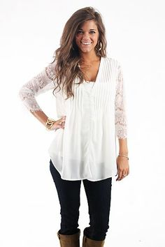 """Sleeves Of Lace $52.00 This top is a fun twist on the classic white button up! The lace sleeves are like accessories of their own, don't be afraid to grab yours before they're all gone!   Fits true to size.   From shoulder to hem:  Small- 28.5""""  Medium- 29""""  Large- 29.5"""""""