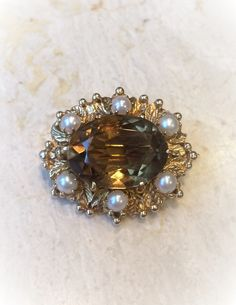 #Gold #brooch with pearls and big #citrine. #England, 1964. Brooch is in the #Victorian style, with a large, faceted citrine, size of the stone is 1.6 x 1.2 cm. Brooch made of the 9 carat gold with the size 2.7 x 2.4 cm, weight is 7.1 grams. Labeled, made in Birmingham in 1964, jeweller HW&S. It's in a perfect condition, clasp works fine.