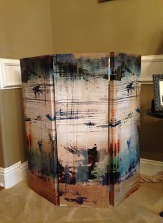 Need a short screen to hide a kitty litter box???? (Can be used for toy area, etc.) This easy-to-make screen was created by attaching 4 small hinges to three inexpensive, 3 X 1 foot canvas paintings!  Now the litter box is out of view AND it's easy to move the screen to clean the box. I made this one for my son's studio apartment where the corner was the only place for the box.