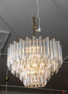 Vintage Oval Shaped Lucite Chandelier | From a unique collection of antique and modern chandeliers and pendants  at https://www.1stdibs.com/furniture/lighting/chandeliers-pendant-lights/