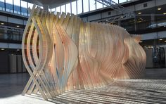 In celebration of the centennial anniversary of the University of Minnesota School of Architecture, Variable Projects designed an installation, called Centennial Chromagraph, that's a life-size representation of the historical moments of the school during their 100-year history. The curvy installation is made up of 100 robotically-routed plywood ribs that are joined together with 8,080 colored #2 pencils.