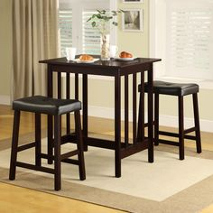 Update your breakfast nook with this Espresso three-piece pub-style table and saddleback stools. With its solid wood frame and black cushioned seats, this set will give your home a comfortable place to share a meal and maximize a small space.