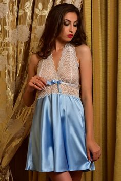 3fbb6a8751a This gorgeous bridal nightgown and robe set is made of stretch satin of  blue color.