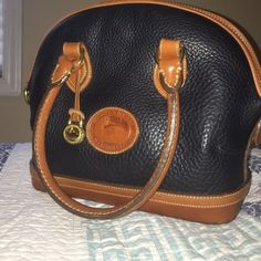 Last day! 100% authentic Dooney & Bourke purse Last day to buy for low price!! goes back up tomorrow at 3pm Has minor scratches/Scuffs on the bottom but other than that it is pretty excellent condition! Also made with the navy all weather leather and I am also negotiatable on the price and all other prices in my closet so fell free to look around! ☺️ Dooney & Bourke Bags