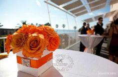 orange flowers, vase could be pink...