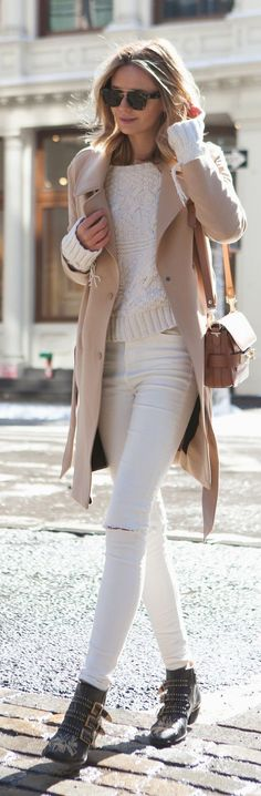 Beige coat over white sweater and jeans.