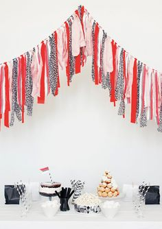 i try to avoid black and red- it has too many bad 90's (and 50's) references. But i like this garland. I would change up the color sceme a bit but i love including some kind of shiny fabric.