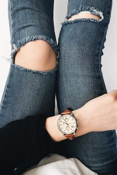 Ripped jeans and a classic boyfriend watch = the ultimate casual Friday ootd. via @ gabbirenee_