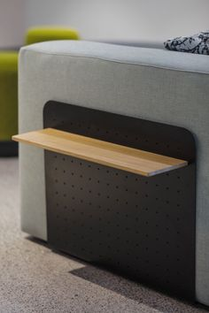 A handy companion for your choice of drink. Series Sofa perforated side table in Satin Black powdercoat and American Oak timber.