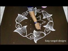 latest sankranthi muggulu designs with dots * simple pongal kolam designs * easy flower rangoli Lotus Rangoli, Indian Rangoli, Diwali Rangoli, Flower Rangoli, Rangoli Designs With Dots, Beautiful Rangoli Designs, Kolam Designs, Rangoli Colours, Rangoli Patterns