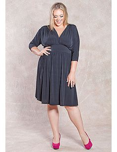 This fabulous new plus size dress modernizes that 70's icon look with soft draping and a swingy skirt. Playful, flirty and oh so sophisticated! Studio 54 style for 2012! sonsi.com