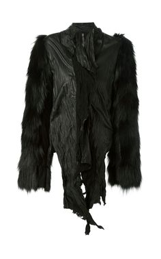 Luxurious black calf leather coyote fur sleeved creased jacket.