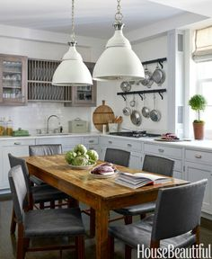 Dyson designed her new kitchen around memories of the upstate New York house where she grew up. The chairs are covered in Great Plains' Marrakesh and the French table, Liza Sherman. The Rover pendants are by Ann-Morris, Inc. Featured in the kitchen is a Wolf cooktop. The sink fittings are from Lefroy Brooks. The cabinets are painted in Farrow & Ball's Cornforth White, with handles by Nanz. The subway tiles are from Heritage.