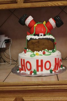 Santa gained a little weight this year! I saw this cake and just HAD to make it!!  Santa and the chimney are made out of RKT and covered  in fondant. The cake is chocolate with buttercream icing.  It was a hit at our Christmas Party!