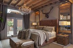 The Master Bedroom has expansive open rafter ceilings, exposed ductwork, a fabulous rustic crystal chandelier. Palo Verde - Houston Business Journal