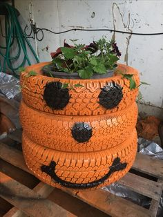 Tire Pumpkin Planter maybe paint it half pumpkin and the other side a snow man