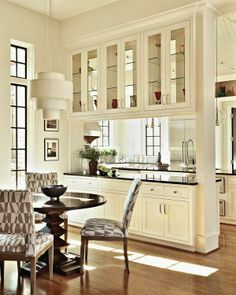 dry bar & display cabinets into kitchen // combined living spaces