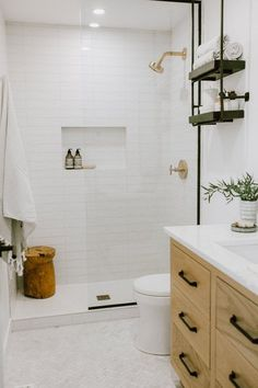Whether you're looking for a little extra storage or you're in the market for a design-forward accent, the bathroom shelving ideas ahead are sure to inspire. #hunkerhome #bathroom #shelving #bathroomshelvingideas #shelvingideas White Bathroom Tiles, Bathroom Renos, Bathroom Renovations, Home Remodeling, White Bathrooms, White Subway Tile Bathroom, Subway Tile Showers, Condo Bathroom, Bathroom Modern