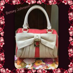 """Betsey Johnson Mini Bow Lock Speedy Betsey Johnson mini bow lock speedy. Comes with detachable strap. Color is Guava and Cream. Fun graffiti print inside. One side zipper pocket and two open pockets on other side. Zipper top closure. Measures approximately 8"""" L x 10"""" W x 4""""d to 5"""" D. Great bag, plenty of room. Soft pebbled faux leather.  New with tags. The cream color is closer to last 2 photos. Betsey Johnson Bags"""