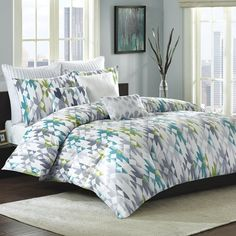 Features:  -Set includes: 1 Comforter, 2 shams.  -Pattern: Geometric.  -Color: Off white, green, blue, turquoise and grey.  -Machine wash cold, gentle cycle, and separately.  -Do not iron.  -Do not bl