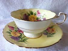 PARAGON TEA CUP AND SAUCER PALE YELLOW SWEET PEAS GOLD GILT