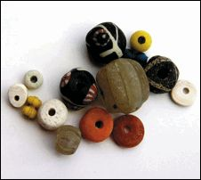 Beads of different kinds from one of the female graves at Fröjel, Gotland. Normally, there were many different  kinds of beads. The grave is from the 9th C.  Photo D.Carlsson