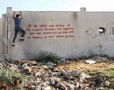 """Banksy Sneaks Into Gaza To Create Controversial Street Art 