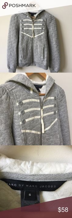 "Marc by Marc Jacobs Quilted Zip Up Hoodie Marc by Marc Jacobs Quilted zip up hoodie. Super cute button and ribbon detailing. Length 23"" Chest 17"". 78% cotton 22% polyester. Great condition! Marc By Marc Jacobs Jackets & Coats"