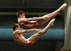 Nick McCrory, left, and David Boudia dive in the men s10-meter platform synchro final at the U.S. Olympic diving trials on Thursday, June 21, 2012, in Federal Way, Wash. The pair won the event.   (AP Photo/Elaine Thompson)          See more in our top weekly photos.