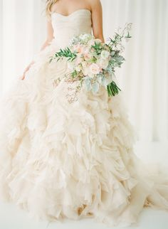 Blush #wedding dress by Monique Lhuillier, bouquet by Ines Naftali Floral & Event Design, image by KT Merry. See more in the Spring 2014 issue of Weddings Unveiled.