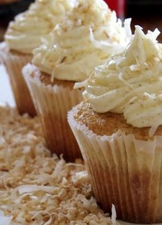 Coconut Cream Pie Cupcakes.. Love fresh coconut.. Think we are missing chocolate here, at least a little drizzle of it.