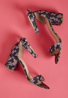 We've Got the Function Block Heel in Navy Floral - From dinner dates to dance parties, these navy heels have your perfectly versatile footwear option covered! Supported by up-to-date block heels, swathed in gorgeous brocade patterned with lilac flowers, this staple pair makes any event to which you flaunt them a fab affair.