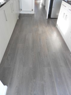 The Winchester Grey is Resistant to impact, abrasion, household chemicals and flame, this board is a must in those busy households. Chromezone technology marks the pores of the board turning the mat surface into a shiny, vibrant natural looking plank. Grey Laminate Flooring, Grey Wood Floors, Best Flooring, Kitchen Flooring, Flooring Ideas, Grey Vinyl Plank Flooring, Grey Oak, Brown And Grey, Grey Hardwood