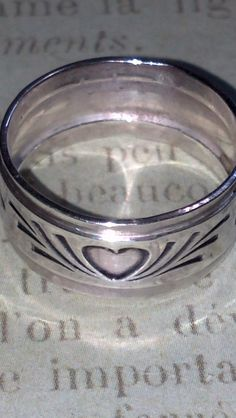 sterling silver ring band heart design by WICKEDWIRED on Etsy https://www.etsy.com/listing/190363681/sterling-silver-ring-band-heart-design
