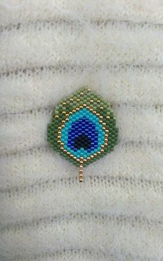 Woven with miyuki beads brooch peyote peacock feather