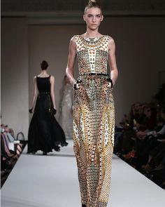 I believe this was inspired by the sheath dress and the print resembles the beaded net dress worn over them.  Designer: Temperley Fall/Winter 2013/14.