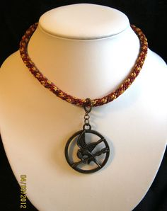 Hunger Games Mockingjay Pendant Necklace  One of a by LotusJewels, $39.99