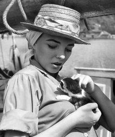 Joan Collins In 1957, British-born actress Joan Collins lounged on a boat that came with its own kitten. Photo: