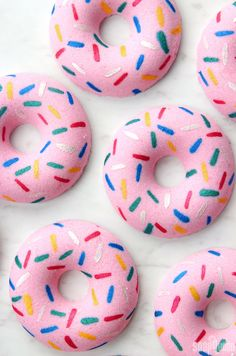 Learn how to make Doughnut Bath Bombs! These doughnut bath bombs look just like classic pink doughnuts with sprinkles, and smell like strawberry.