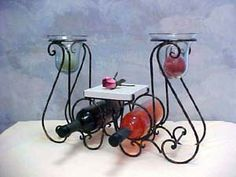 This candle wine rack holds wine and cheese or it could be soap and hand towels. Maybe grapes or other fruit. Has a marble center table with glass hurricanes on both sides. Countertop Wine Rack, Walmart Home Decor, Unique Wine Racks, Wine Candles, Marble Shelf, Iron Candle Holder, Wine Decor, Wine Bottle Holders, Center Table