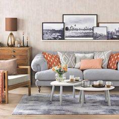 Grey and warm neutrals. Framed prints on floating shelf